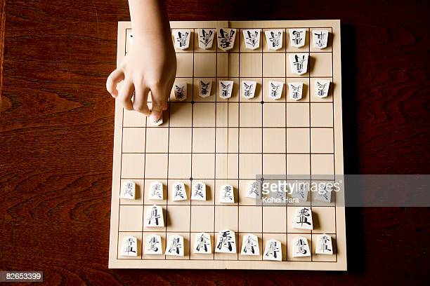 a boy playing shogi game