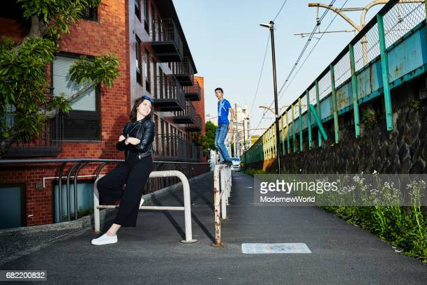 a boy surfs on the lattice and a girl looking at him