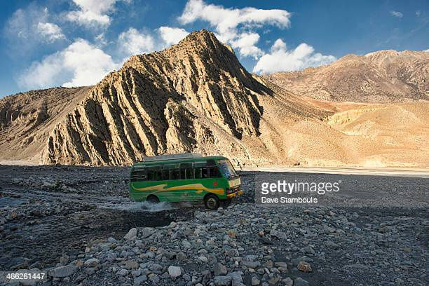 A bus travels up the Kali Gandaki River in the Annapurna region of Nepal