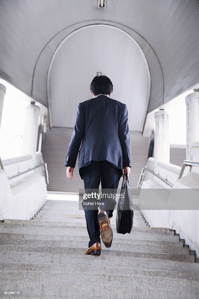 a business man going up the stairs : Stock Photo