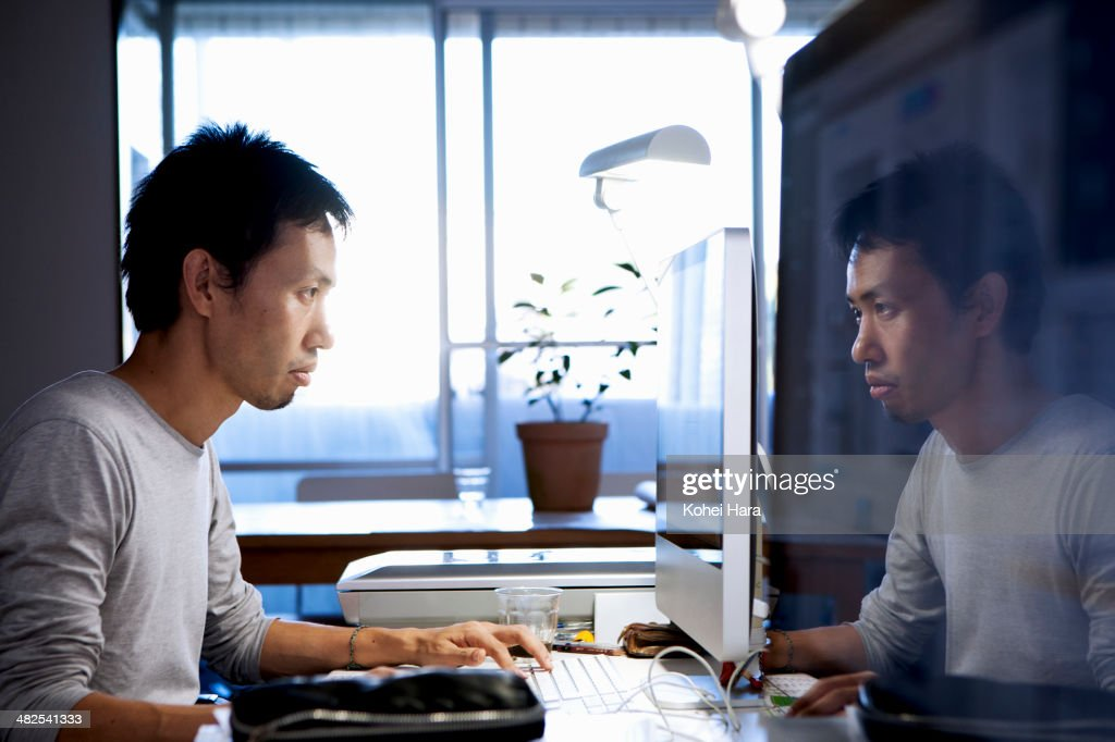 a business man working at office : Stock Photo