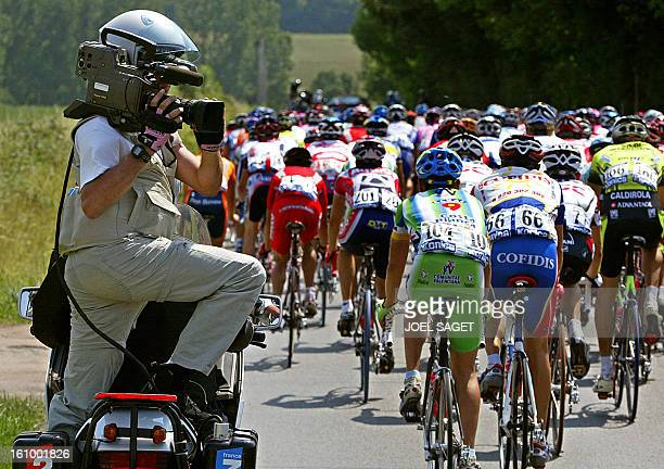a cameraman from French TV channels France 2France 3 works during the sixth stage of the 90th Tour de France cycling race between Nevers and Lyon 11...