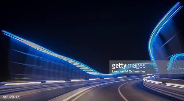 POV of a car / driving over illuminated bridge