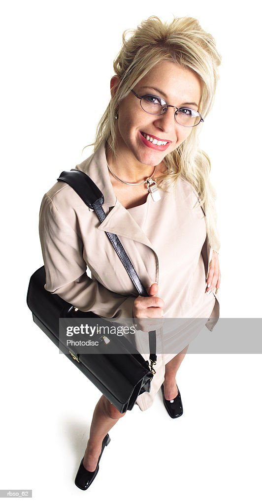 a caucasian blonde business woman holding a black bag smiles as she looks up at the camera : Stockfoto
