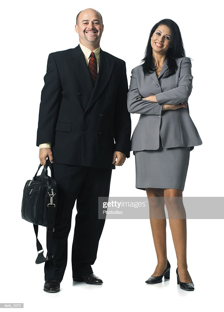 a caucasian business man and an ethnic business woman stand together smiling : Stockfoto