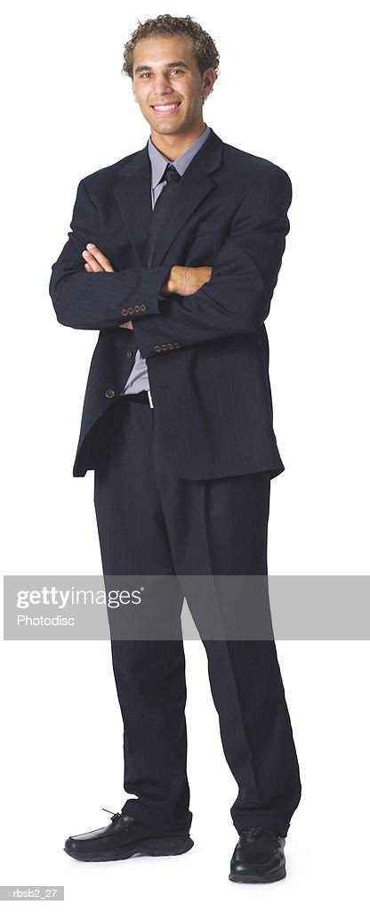 a caucasian business man in a dark suit folds his arms and smiles : Foto de stock