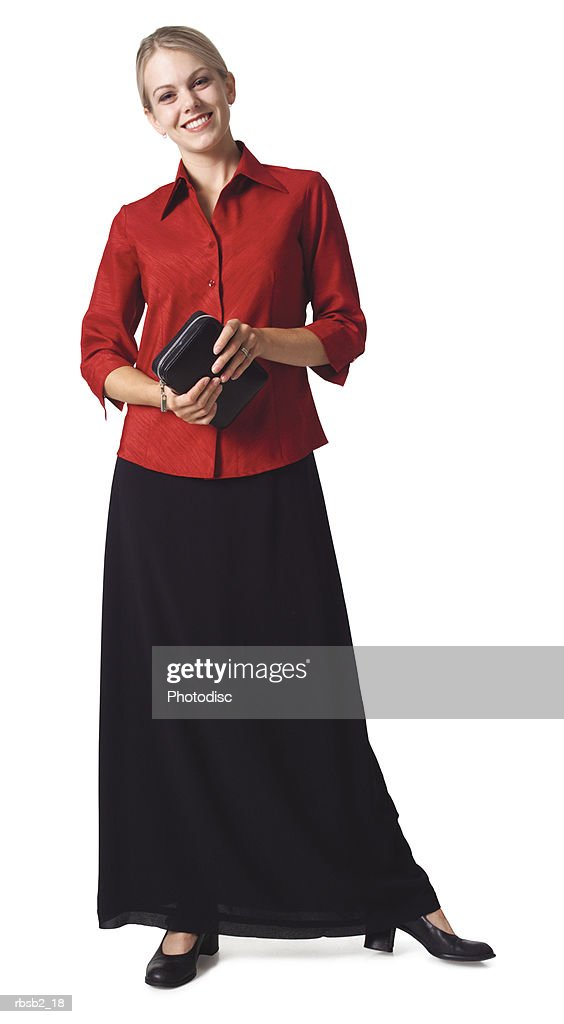 a caucasian business woman in a skirt and red blouse holds her planner and smiles : Foto de stock
