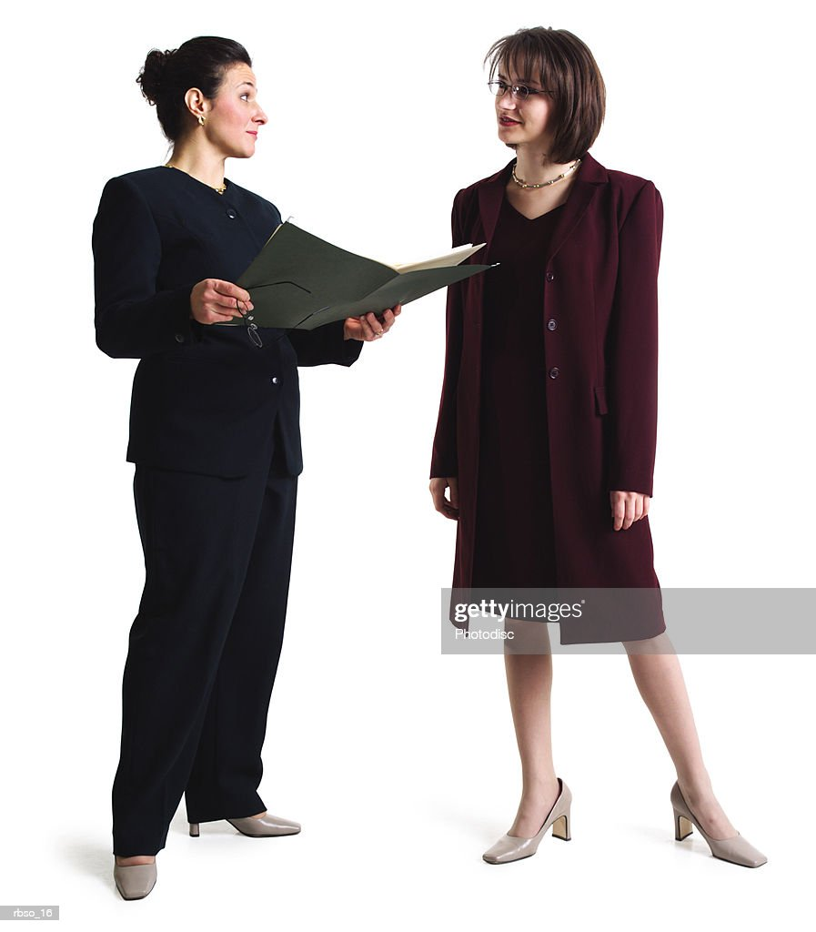 a caucasian business woman shows a file to a female collegue : Foto de stock