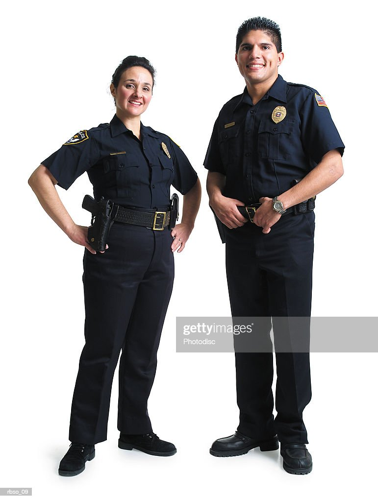 a caucasian female and hispanic male police officers stand together smiling : Foto de stock