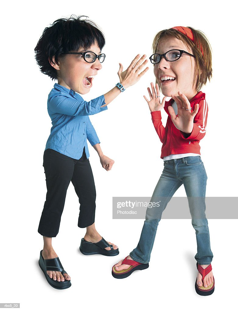 a caucasian female wearing black horn rimmed glasses defends herself against another caucasian female wearing black horn rimmed glasses who is about to slap her : Stockfoto