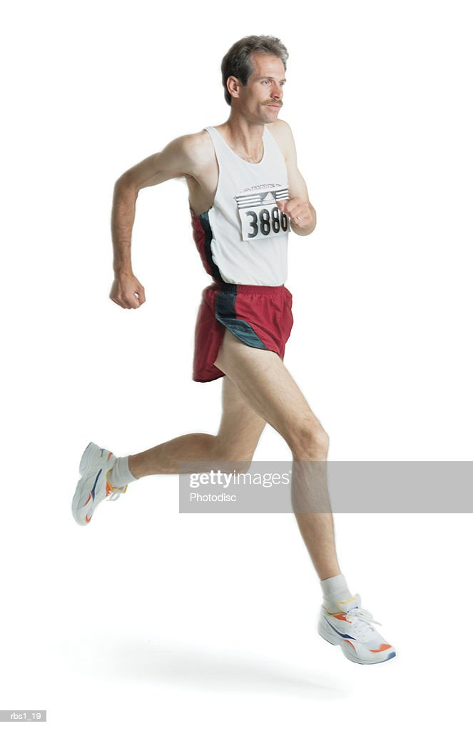 a caucasian man with a mustache is wearing a red track uniform and a marathon number as he runs : Stockfoto