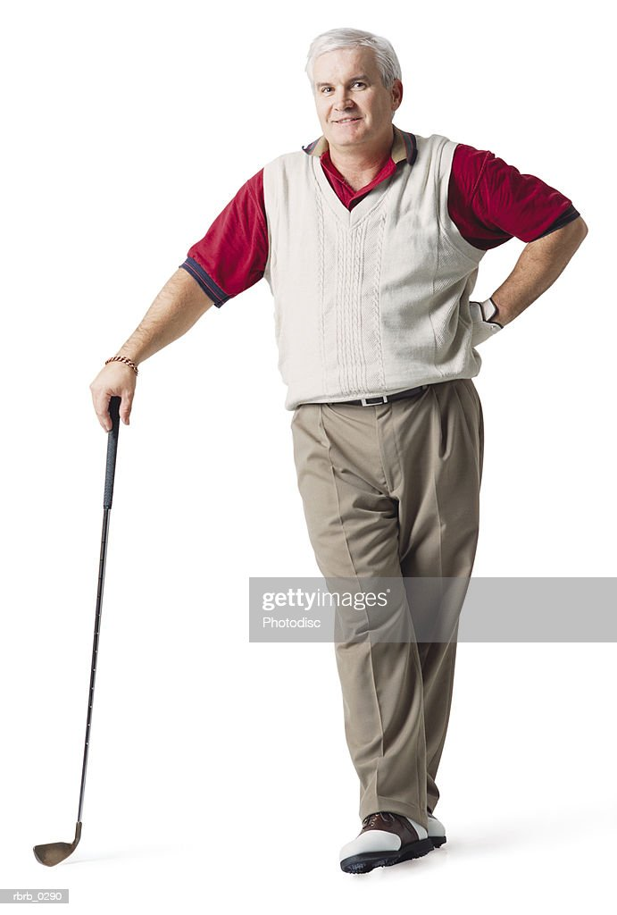 a caucasian middle aged white haired man wearing red and tan is standing while he leans on his club and smiles : Stockfoto
