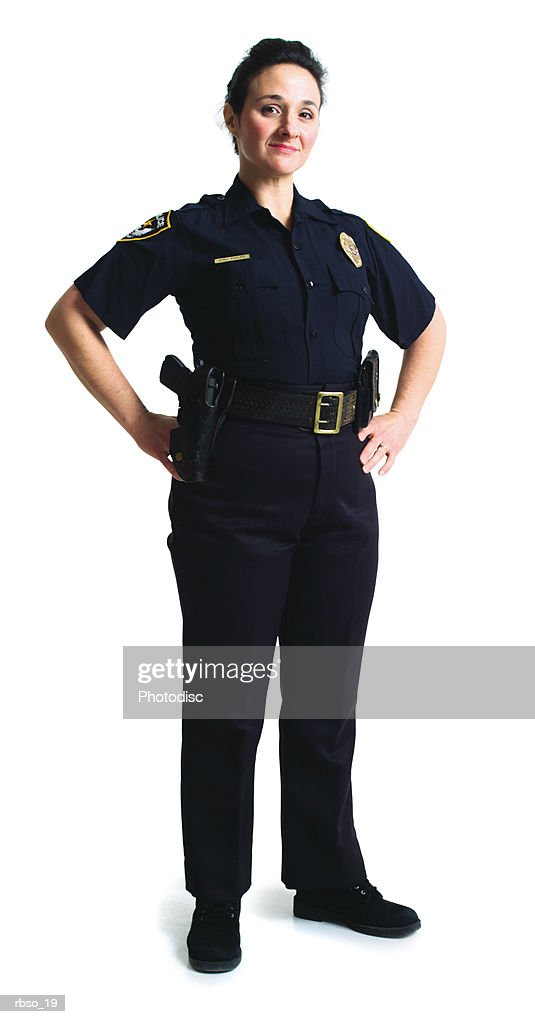 a caucasian police woman stands with her hands on her hips : Foto de stock