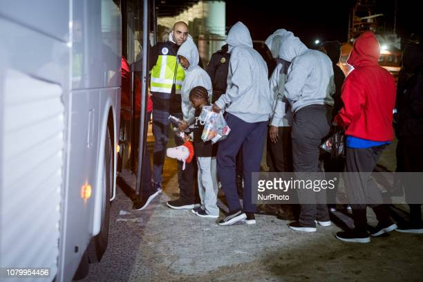 a chil among women waiting to get onto a bus to be transferred to a center on January 7 Malaga Southern Spain