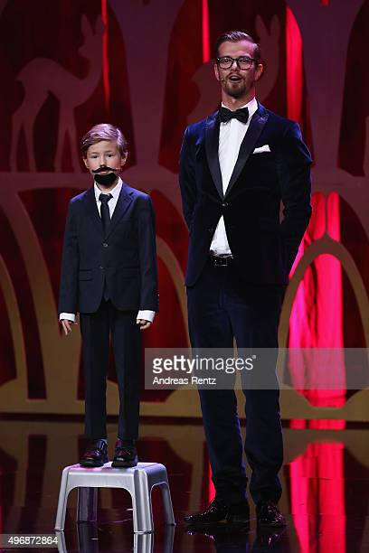 a child dressed up as Klaas HeuferUmlauf and Joko Winterscheidt are seen on stage during the Bambi Awards 2015 show at Stage Theater on November 12...
