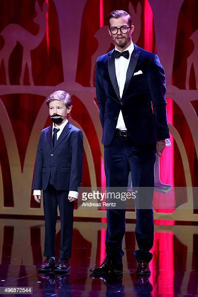 a child dressed up as Klaas HeuferUmlauf and Joko Winterscheidt on stage during the Bambi Awards 2015 show at Stage Theater on November 12 2015 in...