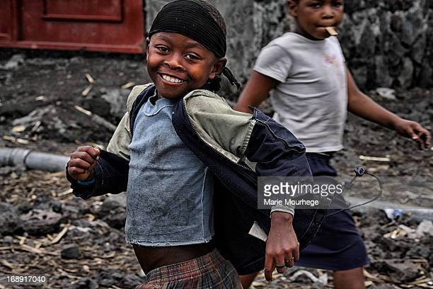 CONTENT] a child in the black volcanic streets of Goma in the Democratic Republic of Conga close to the border of Rwanda where war has been ravaging...