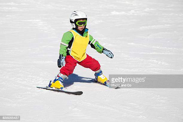 a child (5 years) learns to ski - 4 5 years stock pictures, royalty-free photos & images