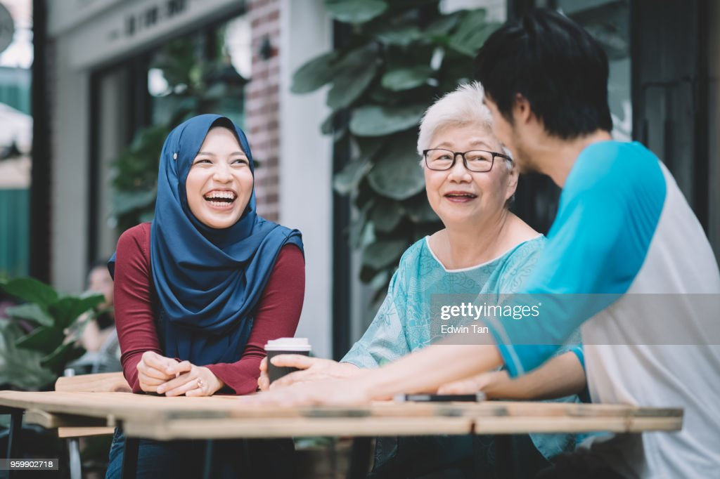 a chinese son introduce his malay girlfriend to his mother for the first time : Stock Photo