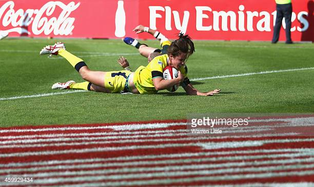 a Chloe Dalton of Australia scores a try against South Africa during the IRB Women's Sevens Rugby World Series at the Emirates Dubai Rugby Sevens on...