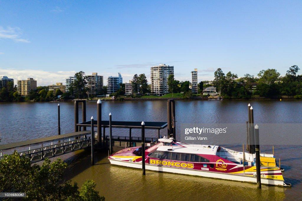 a City Cat ferry on the Brisbane River, Brisbane, Australia, with a Broncos football team logo. : Stock Photo