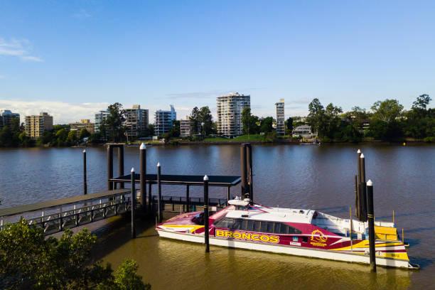 a City Cat ferry on the Brisbane River, Brisbane, Australia, with a Broncos football team logo.