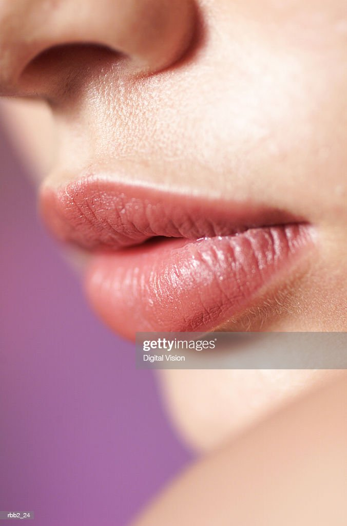 a close up shot of the full lips of a young caucasian girl : Stock Photo
