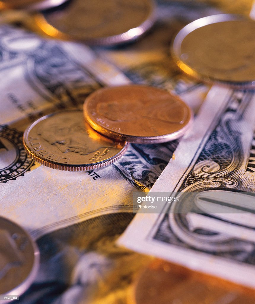 a collection of coins and currency : Foto de stock