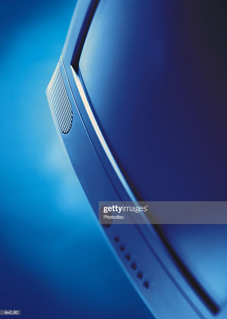 a computer monitor with a blue light shined on it on a blue background : Foto de stock