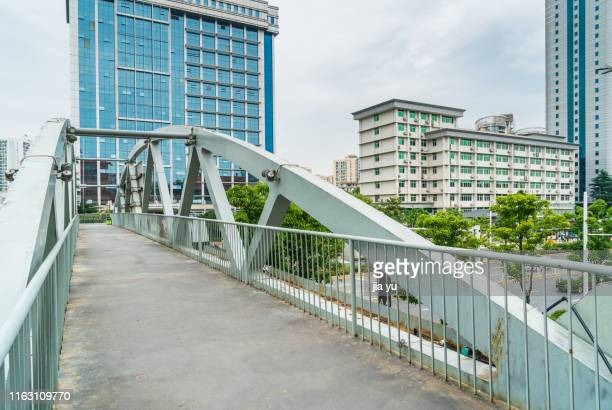 a concrete skywalk in downtown,wuhan - wuhan stock pictures, royalty-free photos & images