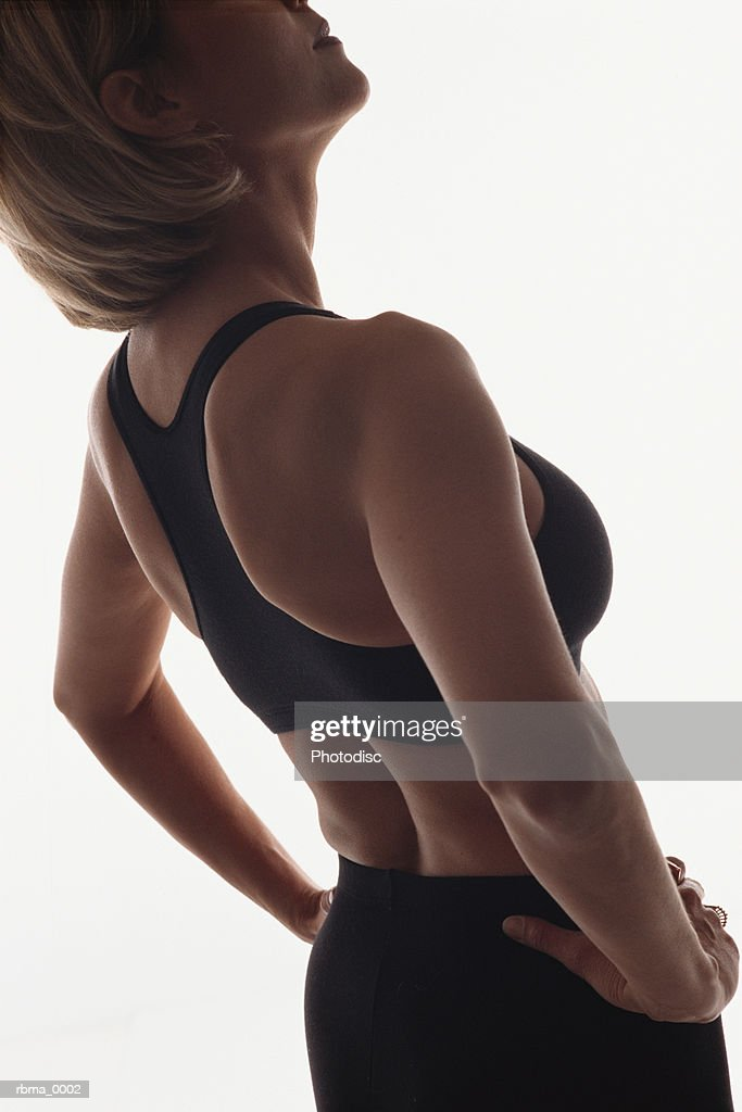 a confident blonde woman stands tall and determined : Stockfoto