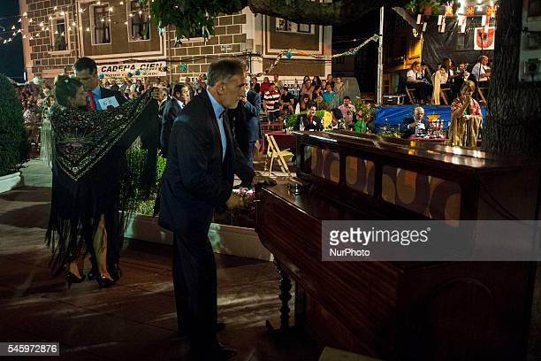 a couple dancing a chotis played by an organ in the Plaza de Ramales de la Victoria during verbena shawl on July 10 2016 VERBENA SHAWL in Ramales de...