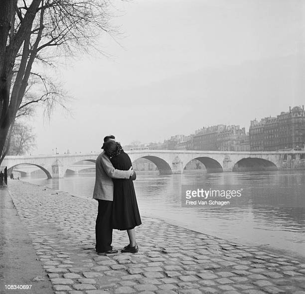 a courting couple on the bank of the Seine Paris 1954