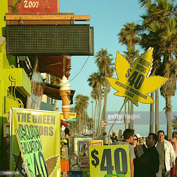 CONTENT] a crowd gathers around a medical marijuana dispensary on the venice beach oceanfront boardwalk in los angeles ca