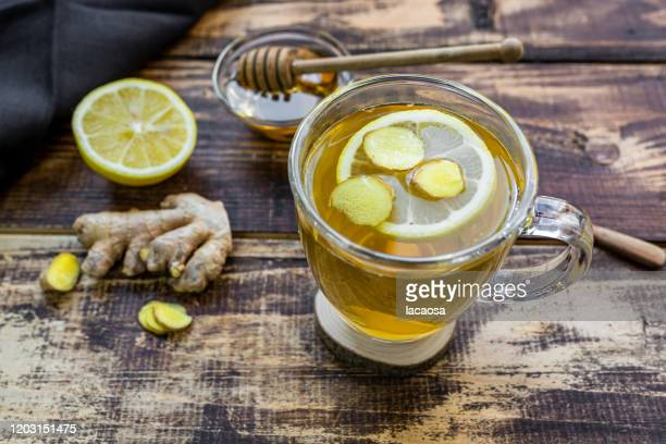 a cup of lemon ginger tea with honey - herbal tea stock pictures, royalty-free photos & images