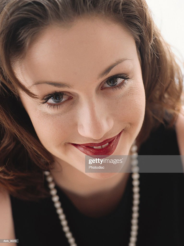 00ccdbafb11 a cute young brunette smiling at the camera wearing a nice black dress and  a string