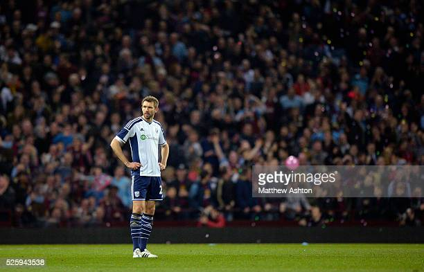 a dejected Gareth McAuley of West Bromwich Albion after they concede the first goal to make the score 10