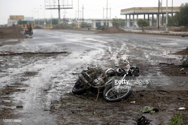 a destroyed Motorcycle following an air strike after clashes between fighters loyal to Saudibacked exiled President Abd Rabbo Mansour Hadi and Houthi...