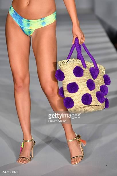 a detail of a beach bag at Versakini x Amanda Perna Runway Show Presented By Ivy at W South Beach on July 13 2016 in Miami Beach Florida