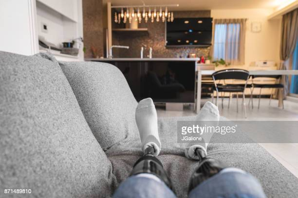 POV of a double amputee relaxing on the sofa
