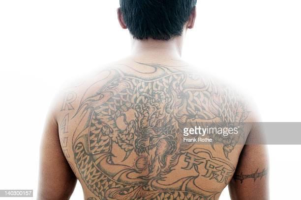 a dragon tatoo on a mans back