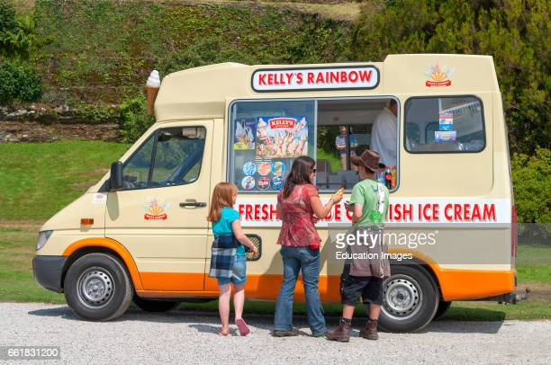 a family buying ice creams from a van seller in Cornwall England UK