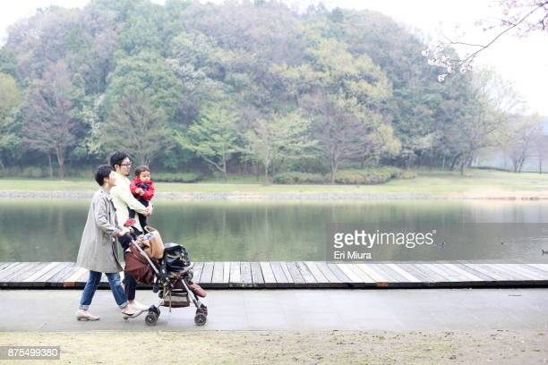 a family is walking in the park - in the park day 3 imagens e fotografias de stock