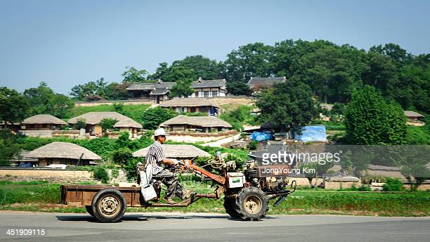 CONTENT] a farmer drives transformed cultivator at Yandong village It is a traditional village located in Gangdongmyeon Gyeongju Gyeongsangbukdo...
