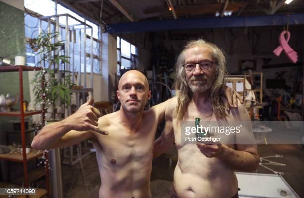 a father and son sharing a marijuana bong. - achteloos stockfoto's en -beelden