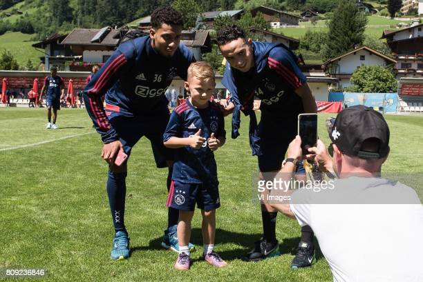 a father is making a picture of his son and Jairo Riedewald of Ajax and Abdelhak Nouri of Ajaxduring the preseason summer training camp of Ajax...