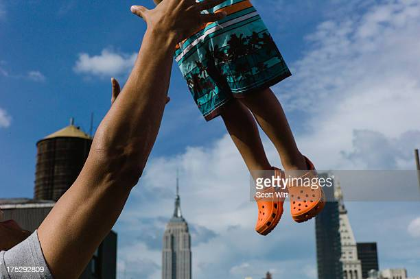 A father throws his son in the air