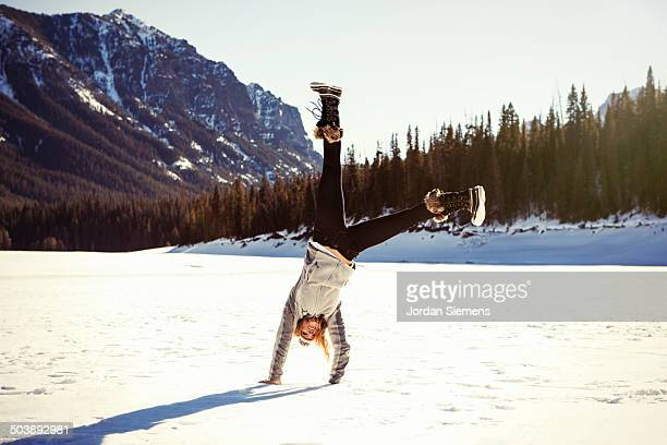 a female doing a cartwheel. - snow boot stock pictures, royalty-free photos & images