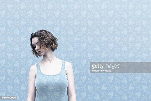 a female dressed same pattern with wall paper 02
