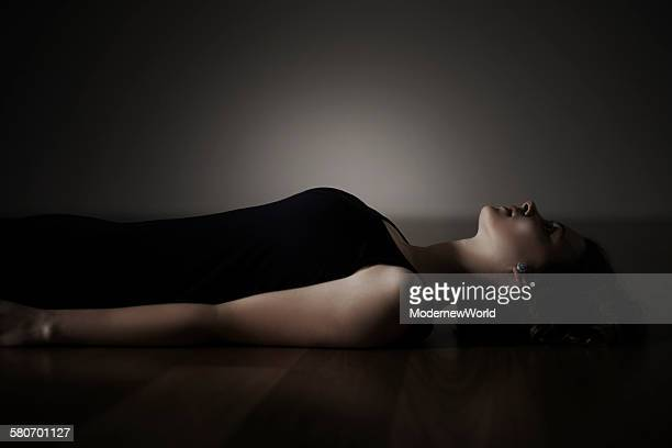 a female lying and looking up on the floor - killing stock pictures, royalty-free photos & images